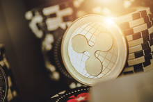 Ripple Coin Crypto Currency And Poker Chips.
