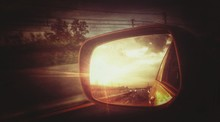 Sunset Reflecting In Side Mirror