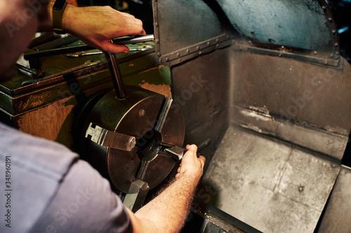 Fotografie, Obraz Professional machinist : man operating lathe grinding machine
