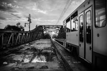 Passenger Train On Railroad Bridge At Dusk