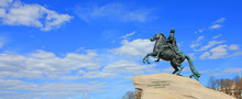 The Bronze Horseman On The Senate Square In Saint Petersburg, Russia. Historic Monument Equestrian Statue Of Peter The Great Isolated On Blue Sky Background In St Petersburg City Center