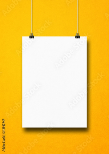 Fotomural White poster hanging on a yellow wall with clips