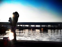Silhouette Of Women With Her Child On Bay