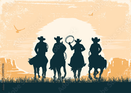 Cowboys silhouette riding horses at sunset landscape Canvas Print