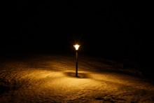 View Of Lit Lamp Post In The D...