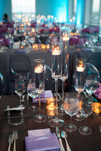 High Angle Vertical Empty Shot Of Table Setting At A Formal Party At Dusk.