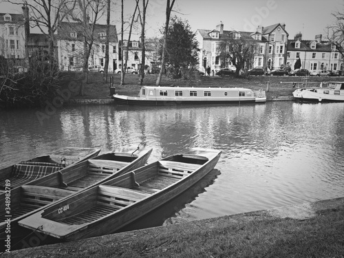 Fotografia Barges And Rowboats Moored On River