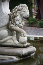 Close-up Of Statue By Pond