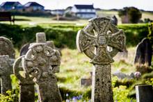 Cross On Tombstone In Graveyard