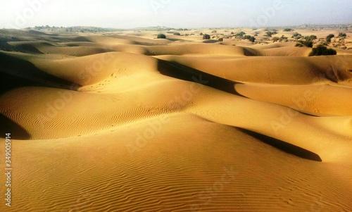 Fotografering Sunlight Falling On Sand Dunes At Thar Desert