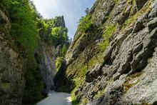 Curvy Road Between Steep Rocks Of Maninska Tiesnava Gorge In Strazovske Vrchy Mountains, Slovakia. Sunny Spring Day.