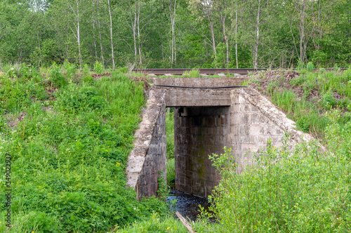 View of the railway with a culvert tunnel made of reinforced concrete blocks on Slika na platnu