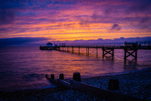 Old Pier In Totland Bay At The Isle Of Wight By Night, UK
