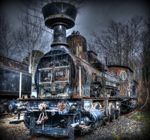 Rusty Old-fashioned Steam Engine Against Sky