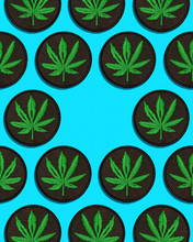 Cannabis Leaf Black Patch In Grid Pattern On Blue Background Center Empty