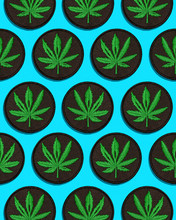Cannabis Leaf Black Patch In Grid Pattern On Blue Background