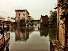 View Of Visconti Bridge And Old Ruin Structure Reflecting On River Mincio
