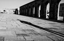 Shadow Of Man On Walkway