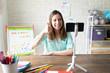 Cute woman teaching kindergarten online