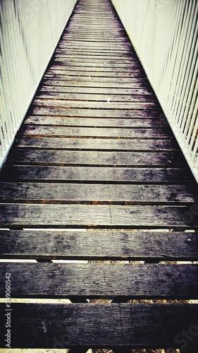 Photo Close-up Surface Level Of Wood Paneled Footbridge