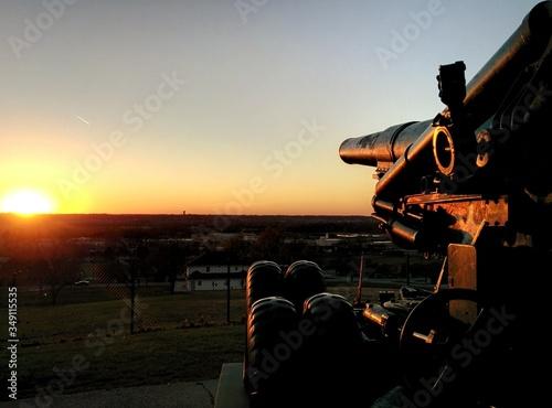 Vászonkép Cannon On Field Against Clear Sky During Sunset