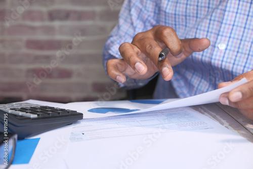 Fototapeta businessman analyzing financial data with copy space  obraz na płótnie