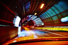 Blurred Motion Of Car In Illuminated Tunnel