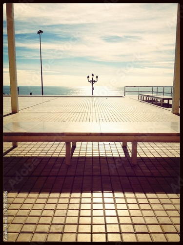 Bench On Observation Deck With Ocean In Background Fototapeta