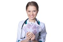 Female Doctor Holding Money Is...