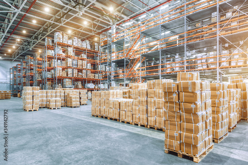 Large industrial warehouse with high racks Fototapet
