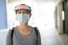 Young Asian Woman Wearing Mask...