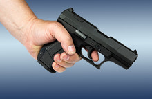 Smooth Gun Holding Before An Abstract Background