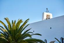 White Ibizan Church With A Bel...