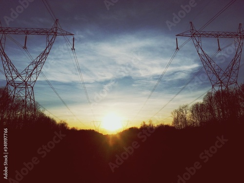 Fotografie, Obraz Electricity Pylons At Sunset