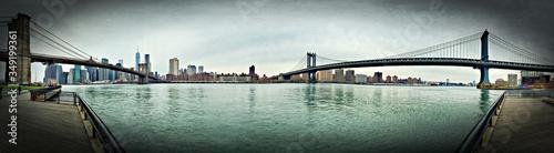 Fotografering Panoramic View Of Brooklyn Bridge And Manhattan Bridge Over East River Against S