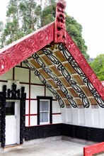 KORINTI, NEW ZEALAND - FEB 23, 2017:  New Zealand Carved Maori Marae (meeting House And Meeting Ground)