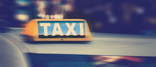Taxi Sign On Top Of Taxi Cab A...