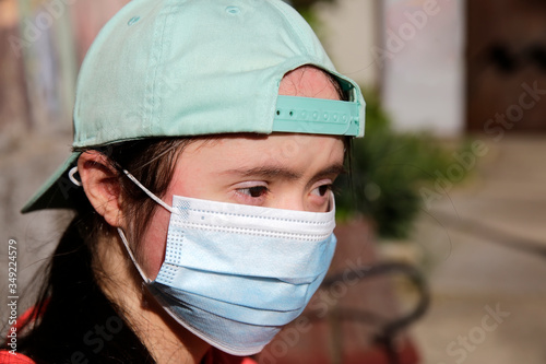 Fototapeta Girl with a mask on her face