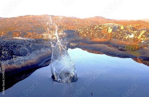 Fotografiet Splash Created By Stone Falling Into Water