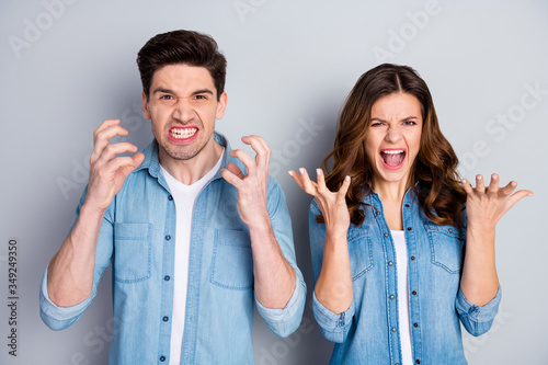 Fototapeta Portrait of frustrated anger crazy married couple have freelance misunderstanding shout yell wear casual style outfit isolated over gray color background obraz