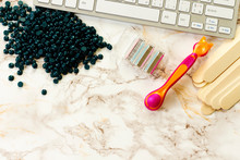 Keyboard And Depilatory Pearly Blue Solid Wax Beans And Wooden Stick, Disposable Razors On Marble Background