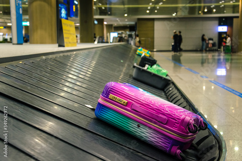 Fotografie, Obraz Rainbow baggage on the claim in airport