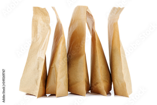 Photo Few brown paper packets on a white background