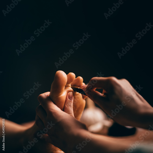 Acupressure foot massage with special stick. Copy space Wallpaper Mural