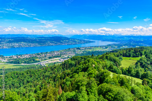 Fototapeta Panoramic view of Zurich lake and Alps from the top of Uetliberg mountain, from the observation platform on tower on Mt. Uetliberg, Switzerland, Europe obraz