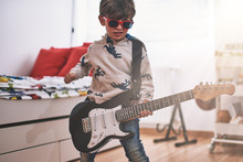 Boy Play Electric Guitar And L...