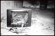 Gutted Tv In A Devastated Room