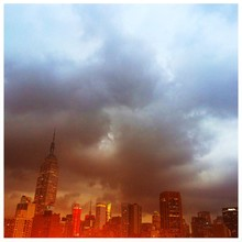 City Skyline With Empire State Building Against Cloudy Sky