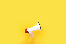 Megaphone In Hand On A Yellow ...