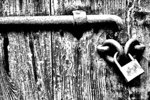 Close-up Of Padlock On Old Wooden Door